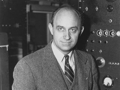 Enrico Fermi, Italian-American physicist, received the 1938 Nobel Prize in physics for identifying new elements and discovering nuclear reactions by his method of nuclear irradiation and bombardment.