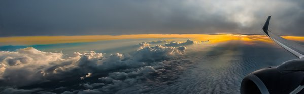 """Last Rays"" Chasing the sunset on a transcontinental flight, the sunset painted its beauty between two layers of clouds. thumbnail"