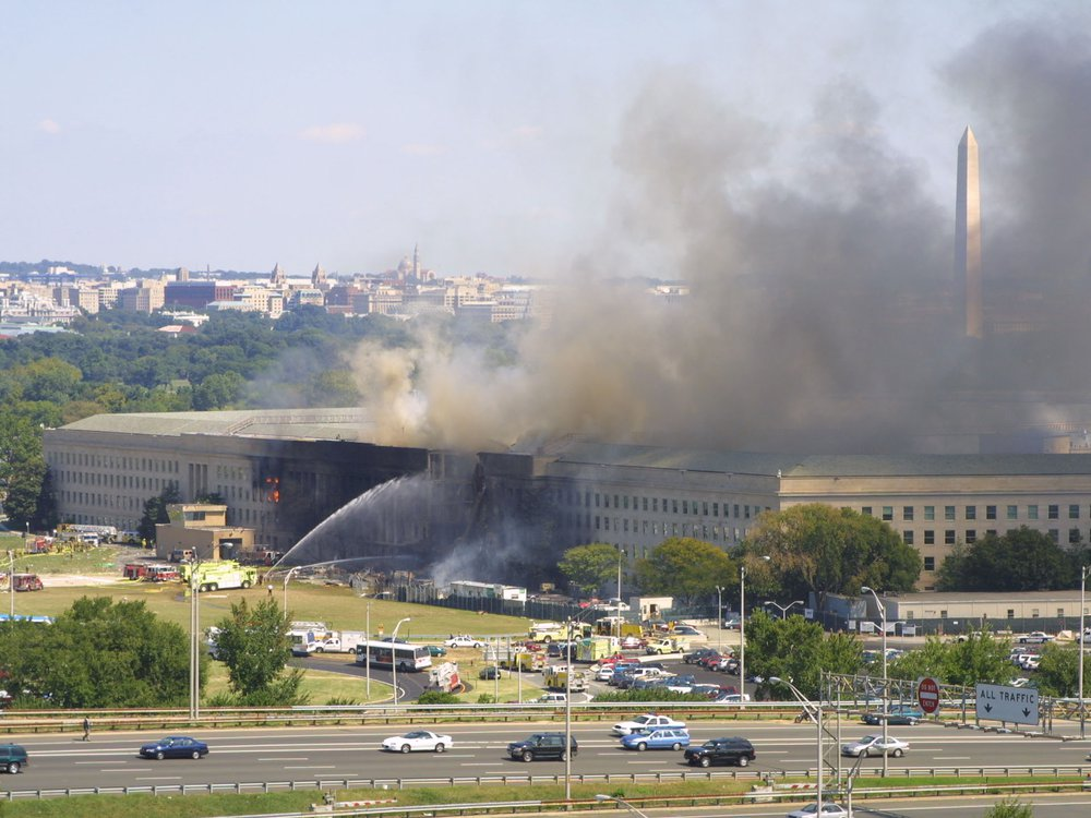 Smoke pours from the west wing of the Pentagon building September 11, 2001 in Arlington, Virginia, after a plane crashed into the building and set off a huge explosion. (Photo by Alex Wong/Getty Images)