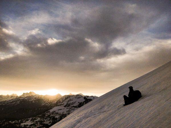 A trek guide enjoying a Himalayan sunrise. thumbnail
