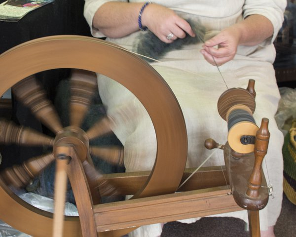 Old Fashioned Spinning Wheel in Action thumbnail