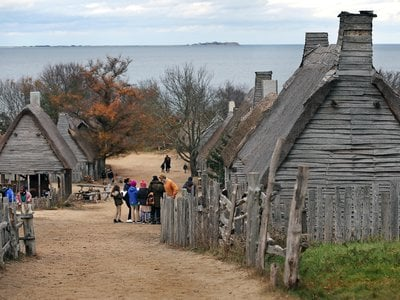Plimoth Plantation is a living history museum that features a recreation of Plymouth's 17th-century English village and a Wampanoag homesite.