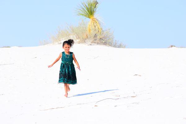 Running around feeling sand on her feet, at White Sands. thumbnail