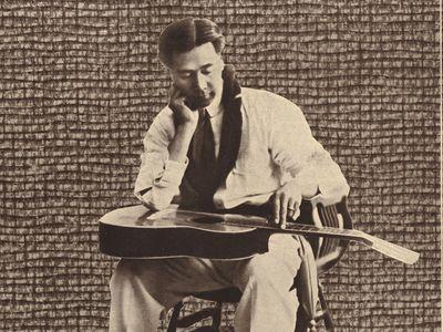 "In 1904, Joseph Kekuku, inventor of the Hawaiian steel guitar, left Hawaii to perform on the American West Coast. Newspaper critics called him the ""world's greatest guitar soloist."""