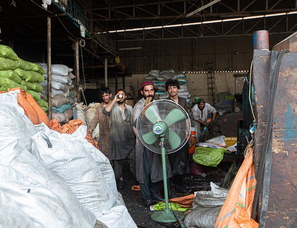 Workers in a Musaffah Plastic Plant thumbnail