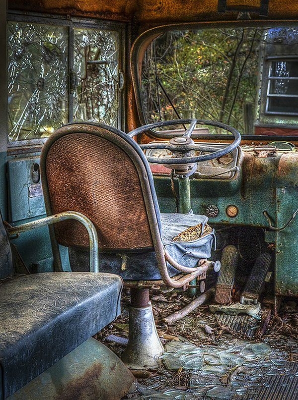 Bus Seat in font of a very old school bus thumbnail