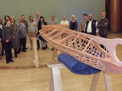 Membersof the staff of the National Museum of the American Indian in New York hold a welcoming ceremony for a kayak frame built in the traditional Yup'ik way at the Qayanek Qayak Preservation Center in Kwigillingok, Alaska. A testament to the ingenuity and innovation of the Native cultures of the Arctic, the kayak frame will become a teaching exhibit when the New York museum's imagiNATIONS Activity Center opens this May. (National Museum of the American Indian, Smithsonian)