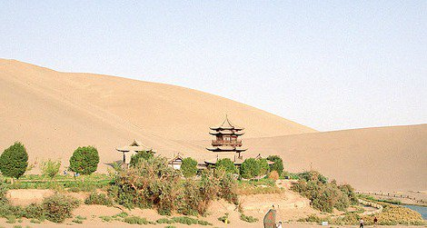 Tourists explore the Crescent Moon Spring along the historic Silk Road trade route.