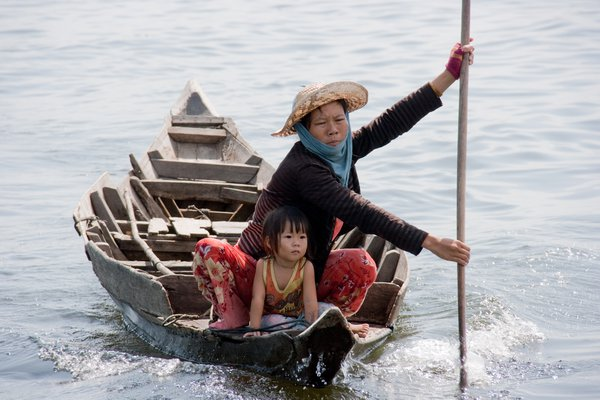 Boatwoman on Tonle Sap, Cambodia thumbnail