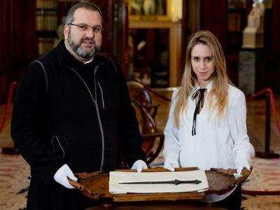 Serafino Jamourlian of the monastery of San Lazzaro degli Armeni and Vittoria Dall'Armellina with a newly rediscovered 5,000-year-old sword
