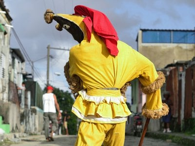 During an initiation ceremony for the Afro-Cuban secret society called Abakuá in the Havana district of Regla, a young aspirant depicts Aberisún, an ireme, or spirit messenger.