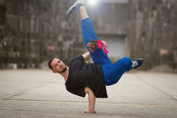 Man holding bouquet and breakdancing on the street thumbnail