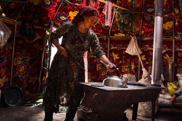 Xinjiang Shepherdess Preparing Milk Tea thumbnail