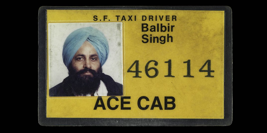 A yellow taxi license with a a picture of Sodhi