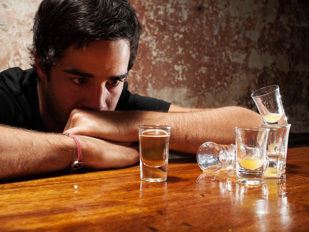 man drinking shots