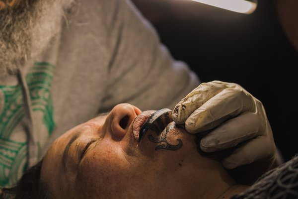Māori woman receives her moko kauae (traditional māori chin tattoo.) thumbnail