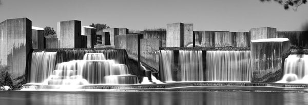 A black and white long exposure shot of Stepping Stone Falls in a serene summer day where the Flint River meets Mott Lake. Flint Michigan