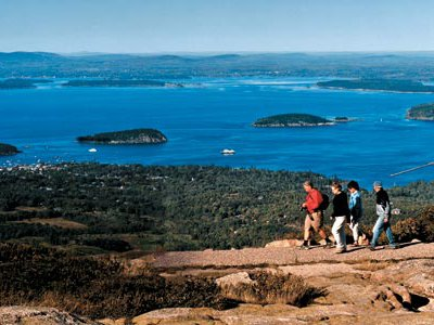 """Mount Desert Island, where hikers trek and ponds beckon has long attracted visitors. """"From our elevation,"""" wrote painter Frederic Church in 1850, """"we had the whole of the seaward part of the island at our feet."""""""