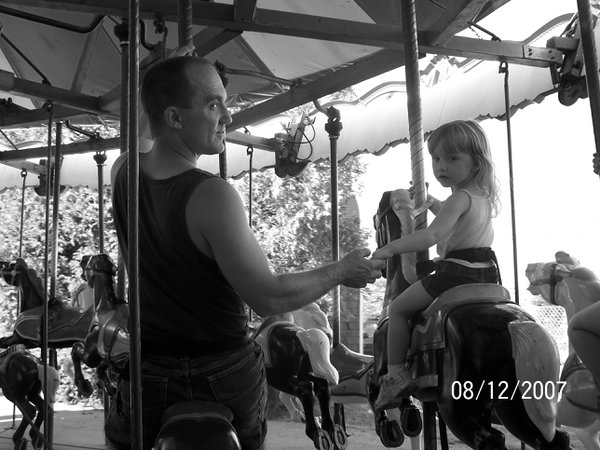 Daddy joins daughter on the Merry-Go-Round thumbnail