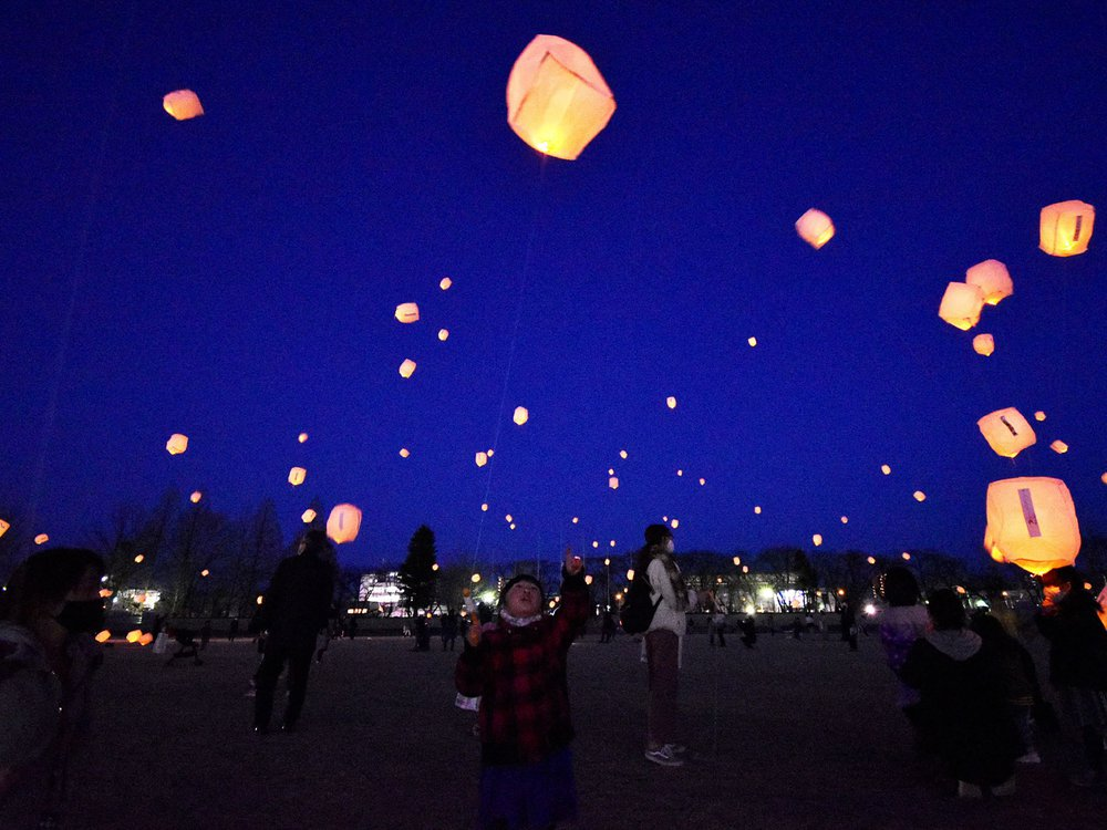 Local residents release lanterns for earthquake and tsunami victims in Koriyama, Fukushima prefecture on March 11, 2021