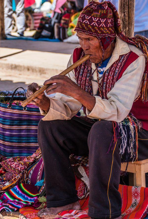 Peruvian man playing flute thumbnail