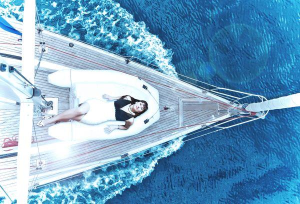 Yulia on her yacht thumbnail