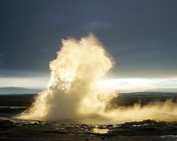 Strokkur geyser erupting at sunrise, Iceland thumbnail