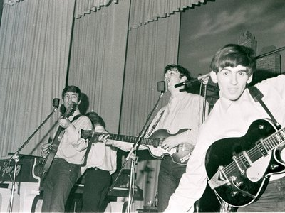 L to R: John Lennon, Paul McCartney and George Harrison perform at the Star-Club in Hamburg, Germany, in May 1962.