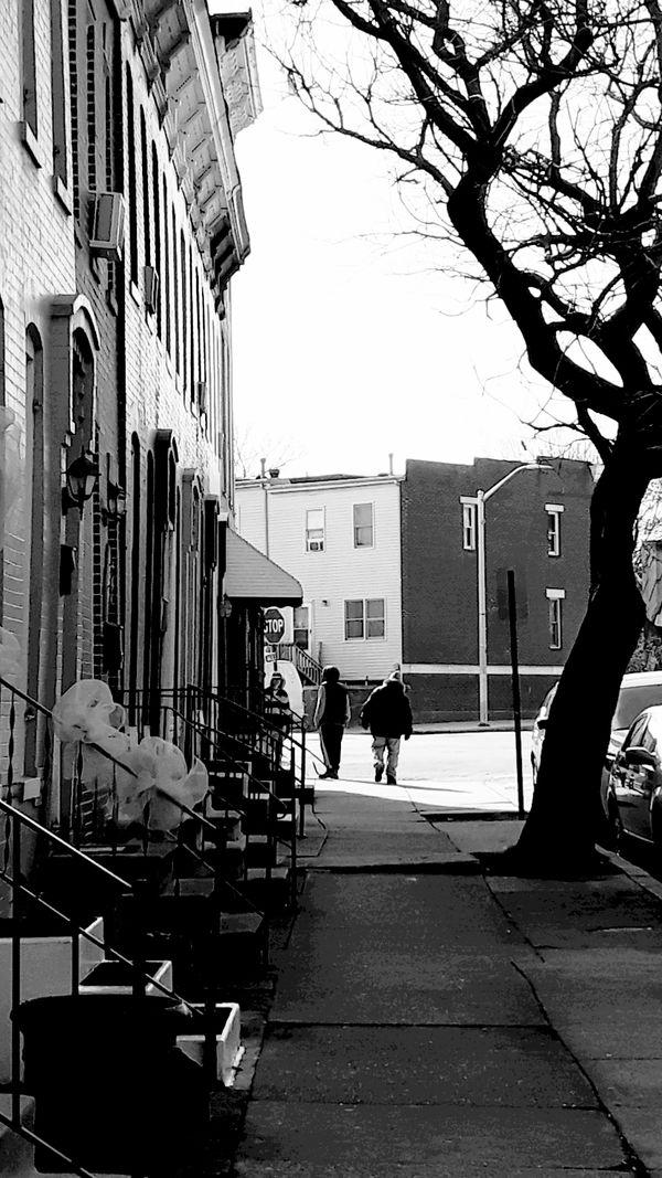 Men walking in Sand Town thumbnail