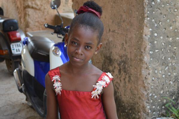 Young woman outside of church in Zanzibar thumbnail