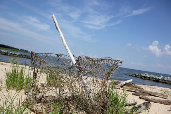 A Lone Crab Pot on a Beach in Maryland thumbnail