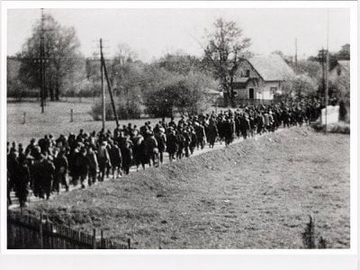 The exhibition includes clandestine photographs of Nazi death marches. This image, taken by Maria Seidenberger, depicts a forced march from Buchenwald to Dachau.