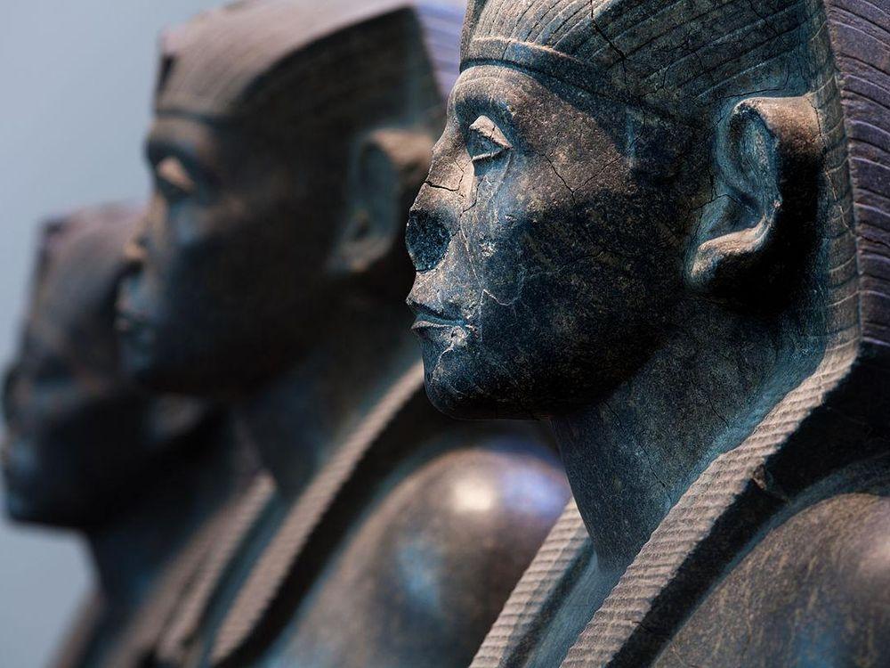 Three black granite statues of the pharaoh Senusret III, c. 1850 BC