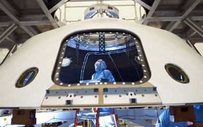 Technicans work on the Mars Science Laboratory, aka Curiosity