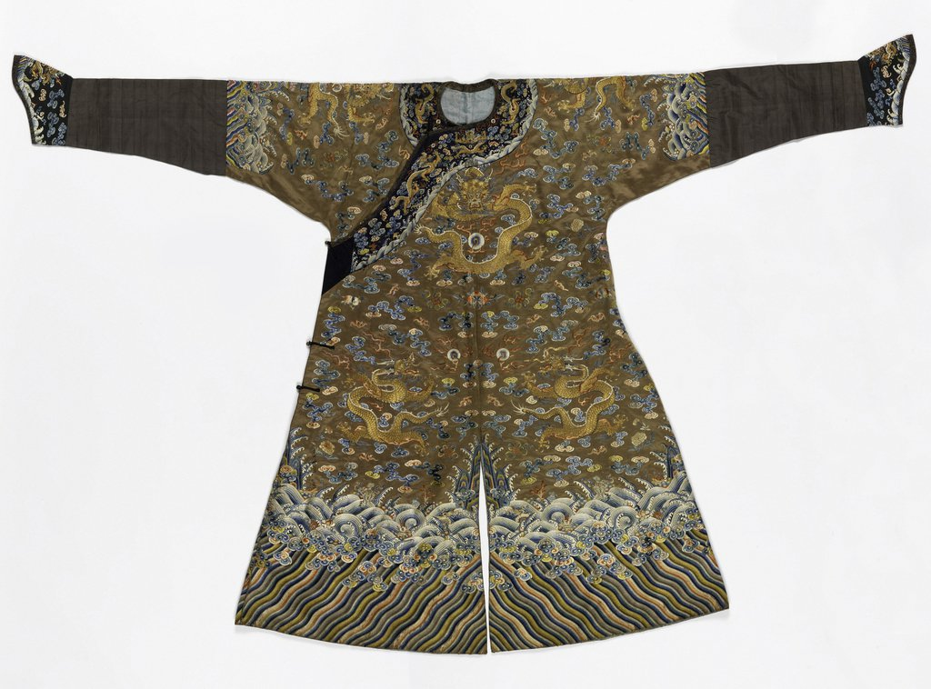 ong robe of brown satin embroidered in colored silks and metallic yarns.Three 5-toed dragons on front, worked in gold with red silk flames and a background of cloud bands in colors, interspersed with symbols such as bat, peony, flaming pearl, lotus, jars
