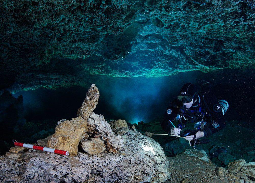 Diver examines rock pile