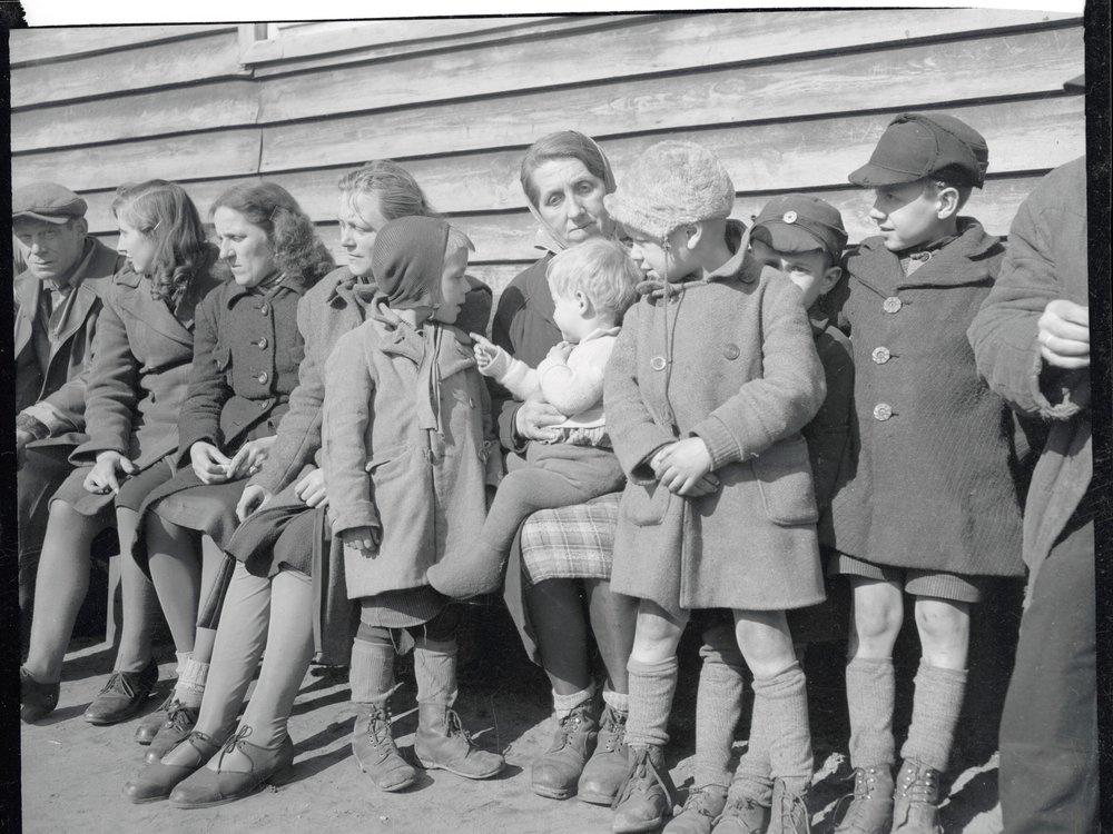 Mother and eight children at displaced persons camp