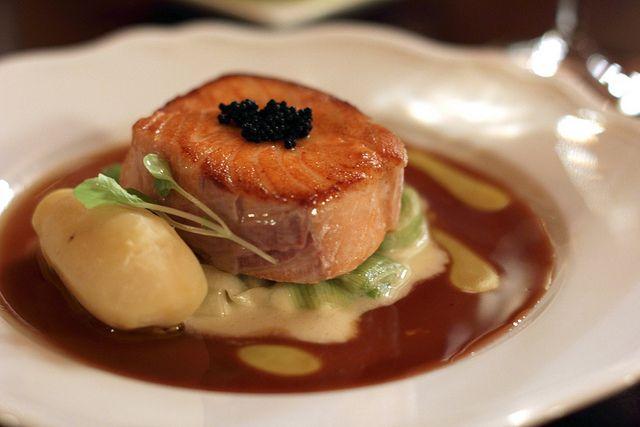Seared Atlantic salmon with sturgeon caviar, braised leeks and pureed potato.