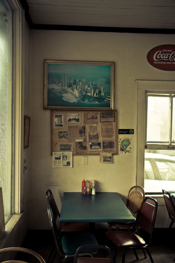 A photograph of NYC with the Twin Towers in Louis Lunch, Gainesville, FL. thumbnail