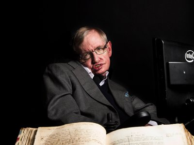 Stephen Hawking with Isaac Newton's annotated copy of Principia Mathematica