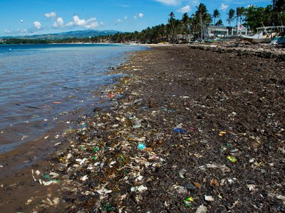 """New models of ocean currents suggest that the oceanic gyres thought to collect garbage actually have """"exit doors"""" that allow plastic to eventually wash up on the shores of North and South America."""