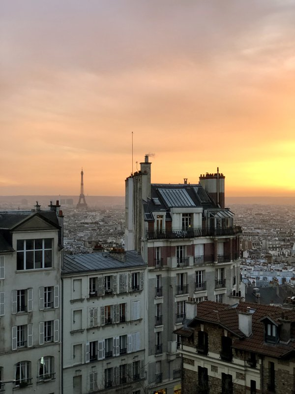 Sunset over Paris, view from a bed room window in Montmartre thumbnail