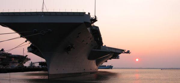 USS Truman at sunset thumbnail