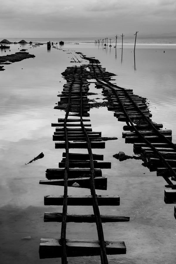 Deserted rail in salt lake thumbnail