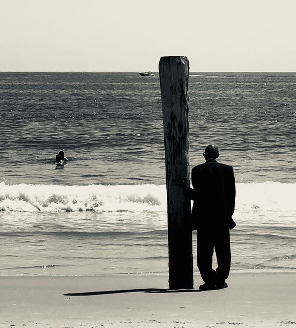 Pensive shot of a man at Ocean City, MD beach thumbnail