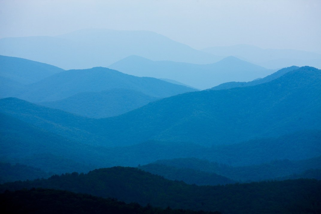 The Appalachian Mountains fade into the distance along the Blue Ridge Parkway on a spring afternoon. (Paul Souders/Corbis)