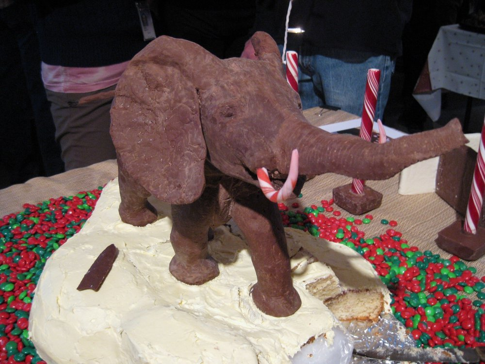 A chocolate model of the African Bush Elephant in the rotunda of the Smithsonian's National Museum of Natural History on top of a festive holiday cake celebrating the museum. (Smithsonian Institution)