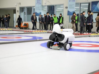 Researchers test out Curly, an AI-powered curling robot, in 2018.