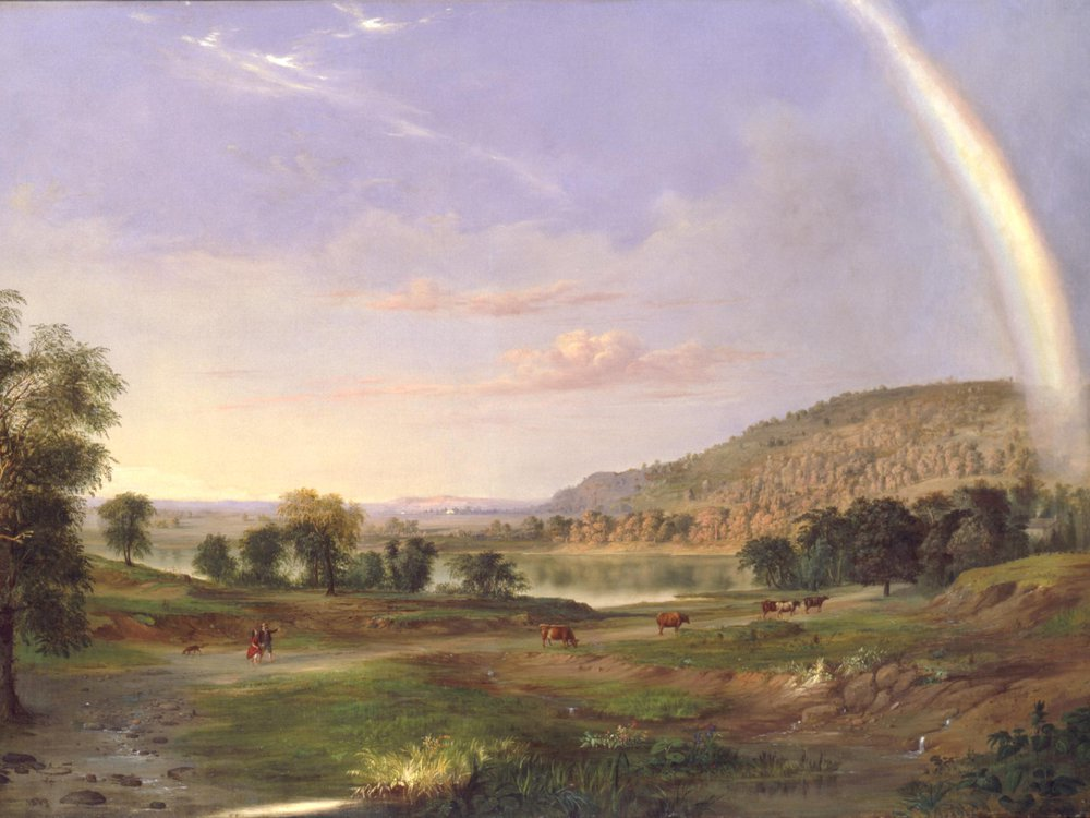 A landscape painting looking over a gently sloping green field dotted with cows and a couple walking in the distance; the man gestures out at a large rainbow extending through the right of the canvas, into the blue-purple sky