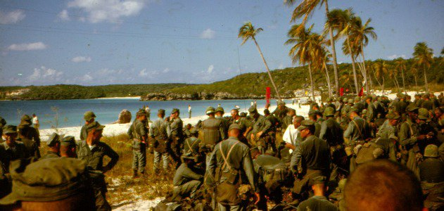 """""""Sweaty troops on the beach prepare to move out."""""""